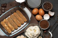 Ingredients for making traditional italian cake tiramisu on concrete table. Ingredients for making traditional italian cake tiramisu on concrete background or stock photos