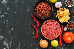 Ingredients for Mexican dishes chili con carne. Black concrete background, top view, space for text. stock image