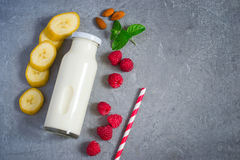 Ingredients for milkshake with juicy ripe raspberries and almond. S. Top view with copy space Stock Image