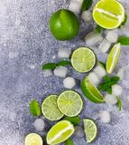 Ingredients for Mojito. Fresh lime, mint and ice. Fresh lime, mint and ice on grey background. Ingredients for Mojito stock photo