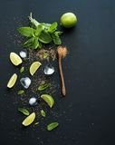 Ingredients for mojito. Fresh mint, limes, ice Royalty Free Stock Images