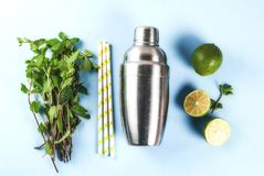 Ingredients for mojito or lemonade cocktail. Ingredients for cocktail mojito or lemonade - lemon, lime, mint, sugar, with shaker and cocktail straws. On a light stock photography