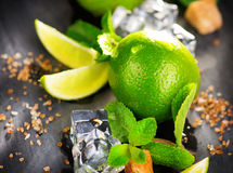 Ingredients of Mojito. Lime, mint, ice cubes and brown sugar Stock Photography