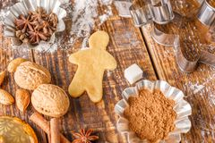 Ingredients and molds for making classic ginger biscuits on a wooden table. stock image
