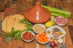 Ingredients for a Moroccan dish with lamb and vegetables. Ingredients for a Moroccan tagine dish with chick peas, lamb, carrots, celery, lemon, onion, cinnamon stock photo