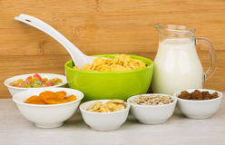 Ingredients for muesli in bowls and jug milk Stock Photography