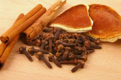 Ingredients for mulled wine 2. Ingredients for mulled wine - cinnamon, cloves, orange peel - on beech chopping board Royalty Free Stock Images