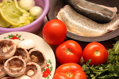 Ingredients. Mushroom potato meal food vegetables dinner fresh baked trout bell pepper fish Stock Photography