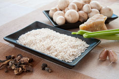 Ingredients for mushroom risotto served with tasty cheese Royalty Free Stock Photography