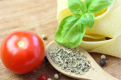 Ingredients. Noodles with tomatoe, basil and herbs Stock Photo