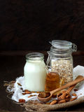 Ingredients for oatmeal or cookies  - cereal, honey, raisins, milk, almonds. healthy breakfast. Stock Photography