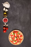 Ingredients Of Pizza On The Chalkboard (with Copy Space) Royalty Free Stock Image