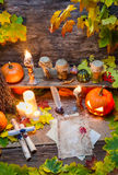 Ingredients and old scrolls on the table witches Royalty Free Stock Photo