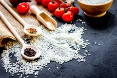 Ingredients for paella on dark background stock photo