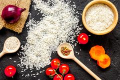 Ingredients for paella on dark background top view Royalty Free Stock Photo