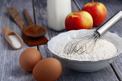 Ingredients for pancakes. Food ingredients to make American style pancakes with apples including flour, milk, eggs Stock Photos