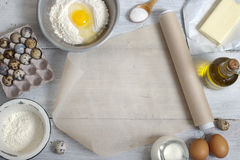 Ingredients for the pancakes on the white table around the parch Royalty Free Stock Images