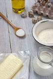 Ingredients for the pancakes on the white table around the parch Royalty Free Stock Photo