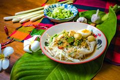 Rice noodles with spicy fish sauce. Ingredients of papaya salad, papaya, lime, lemon, garlic, dried chilies. Thai food Royalty Free Stock Photography