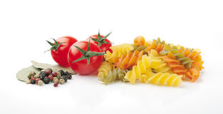 Ingredients for pasta. Pasta, Tomatoes, Peppercorn and Bay Leaves on White Background Royalty Free Stock Image