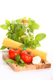 Ingredients of pasta. Fresh tomatoes with spaghetti pasta royalty free stock images