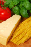 Ingredients for pasta. Spaghetti, tomatoes, basil and parmesan cheese royalty free stock photo