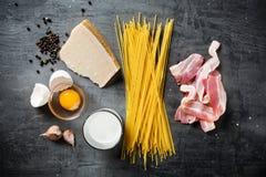 Ingredients for Pasta Carbonara. On dark background Stock Photos