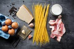 Ingredients for Pasta Carbonara. On dark background Royalty Free Stock Photos