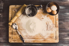 Ingredients for pasta making. On the wooden table. Toned image Stock Image
