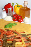 Ingredients for a pasta meal. Include tomatos, oil, garlic, cheese, salt, pepper and different kind of pasta royalty free stock photos