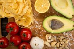 Ingredients for pasta. Raw ingredients for pasta with vegetarian pesto sauce Stock Photography