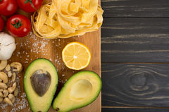 Ingredients for pasta. Raw ingredients for pasta with vegetarian pesto sauce Stock Images