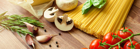 Ingredients for pasta and sauce. Top view, view from above. Copy space. Dark background. banner. Pasta spaghetti with tomatoes, sauce bolognese, cheese and basil Stock Photography