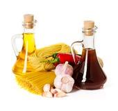 Ingredients for pasta. Spaghetti, chili, oil, garlic Royalty Free Stock Photo