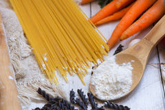 Ingredients for pasta: spaghetti, vegetables and spices on the old table Stock Photography