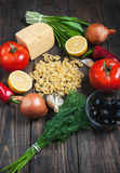 Ingredients for pasta, vegetables on an old table. top view Royalty Free Stock Photography