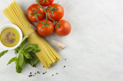 Ingredients for paste: spaghetti, basil, tomatoes, garlic, peppe Royalty Free Stock Photography