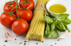 Ingredients for paste: spaghetti, basil, tomatoes, garlic, peppe Stock Photo