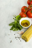 Ingredients for paste: spaghetti, basil, tomatoes, garlic, peppe Royalty Free Stock Image