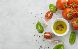Ingredients for paste: spaghetti, basil, tomatoes, garlic, peppe Royalty Free Stock Photos