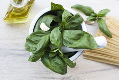 Ingredients for Pesto alla Genovese. Basil, parmesan, garlic, olive oil Royalty Free Stock Photography