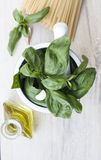 Ingredients for Pesto alla Genovese. Basil, parmesan, garlic, olive oil Stock Photography