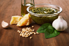 Ingredients for pesto. Pesto alla genovese and ingredients on wooden table Stock Images