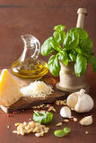 Ingredients for pesto sauce over wooden rustic background Royalty Free Stock Images