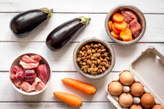 Ingredients for pet food holistic top view on wooden background.  Royalty Free Stock Photography