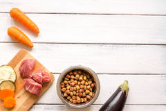 Ingredients for pet food holistic top view on wooden background.  Royalty Free Stock Photo