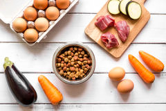Ingredients for pet food holistic top view on wooden background.  Stock Photo