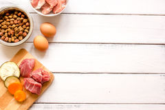 Ingredients for pet food holistic top view on wooden background.  Stock Photography