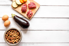 Ingredients for pet food holistic top view on wooden background Stock Photo