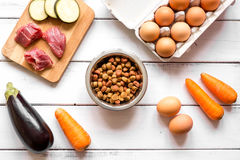 Ingredients for pet food holistic top view on wooden background Stock Photos